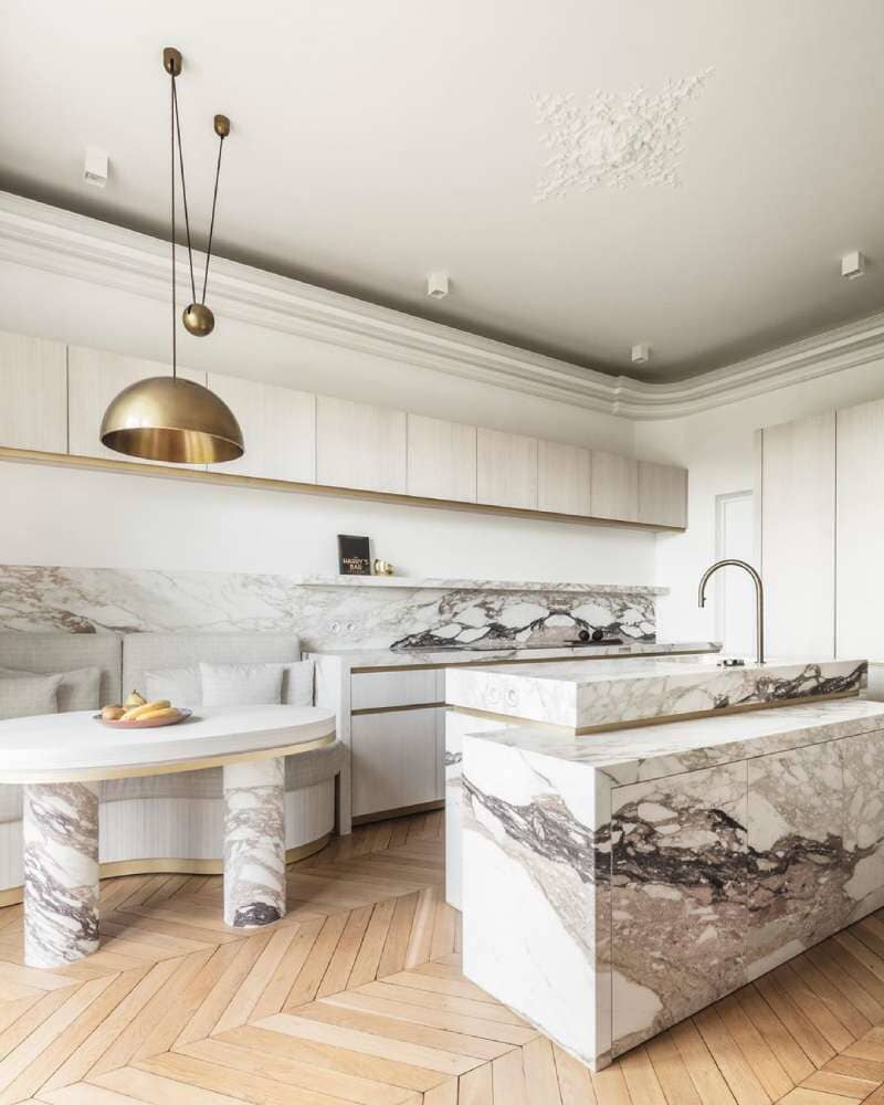 Classic herringbone hardwood with gorgeous natural stone accents in Bridgeport, CT