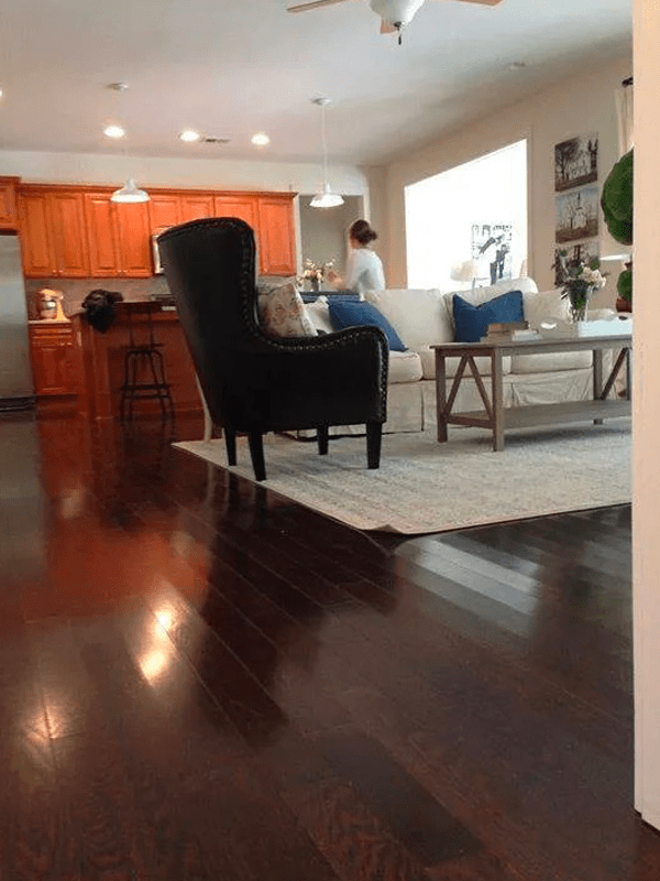 Dark tone hardwood flooring in Buena Ventura Lakes, FL from The Carpet and Tile Center Inc.