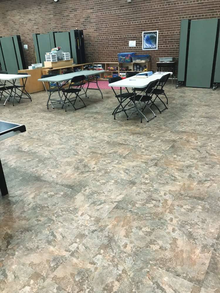 Dining area flooring installation in Iowa from Hiller Stores
