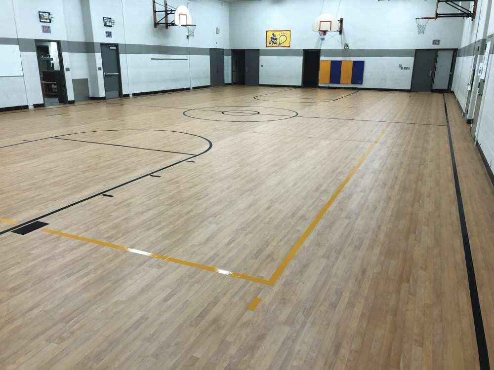 Basketball court flooring installation in South Dakota from Hiller Stores