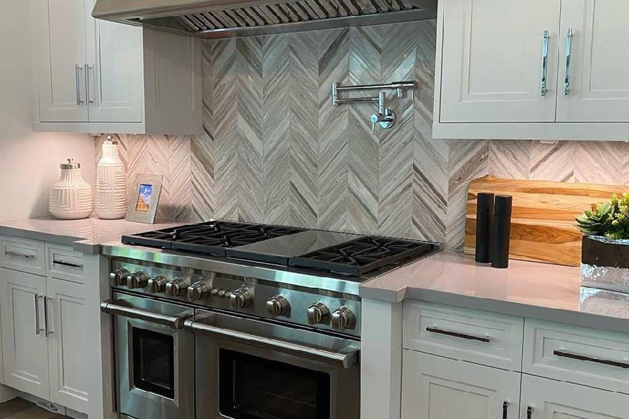 Gorgeous kitchen backsplash done with porcelain tile in a herringbone pattern in Delray Beach, FL
