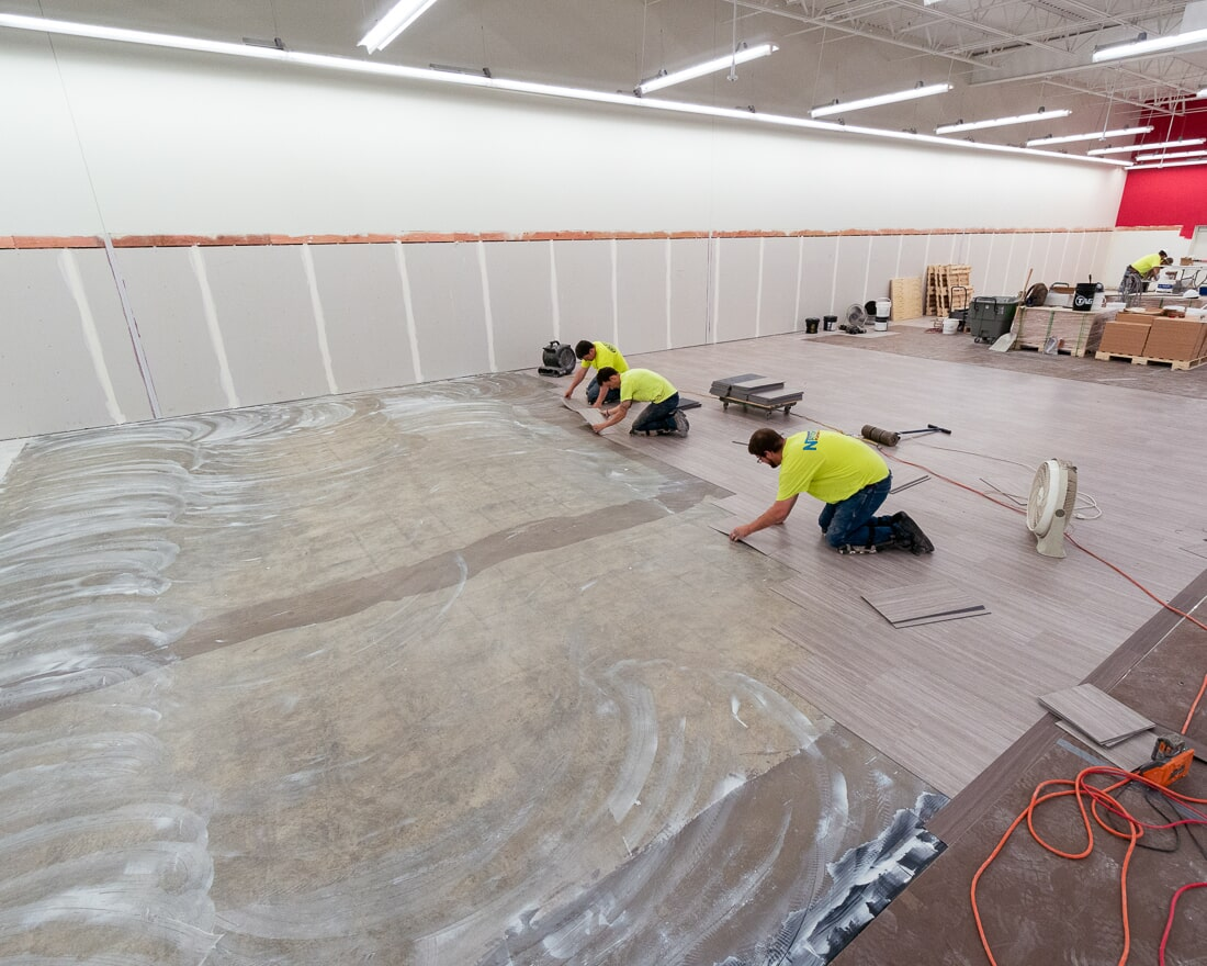 Installing commercial flooring at Burlington in Burbank, IL from Carlson's Floors