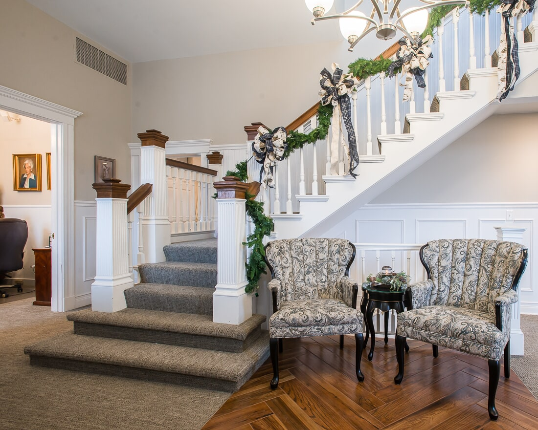 Stair carpet and herringbone hardwood at Malone Funeral Home in Geneva, IL from Carlson's Floors
