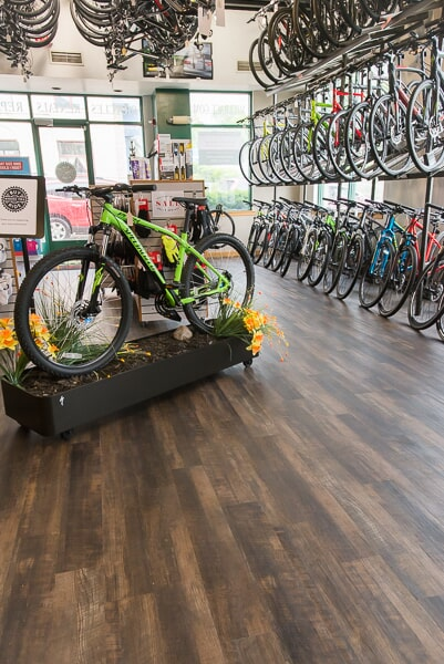 Commercial LVT installation at Mill Race Cyclery in Geneva, IL from Carlson's Floors