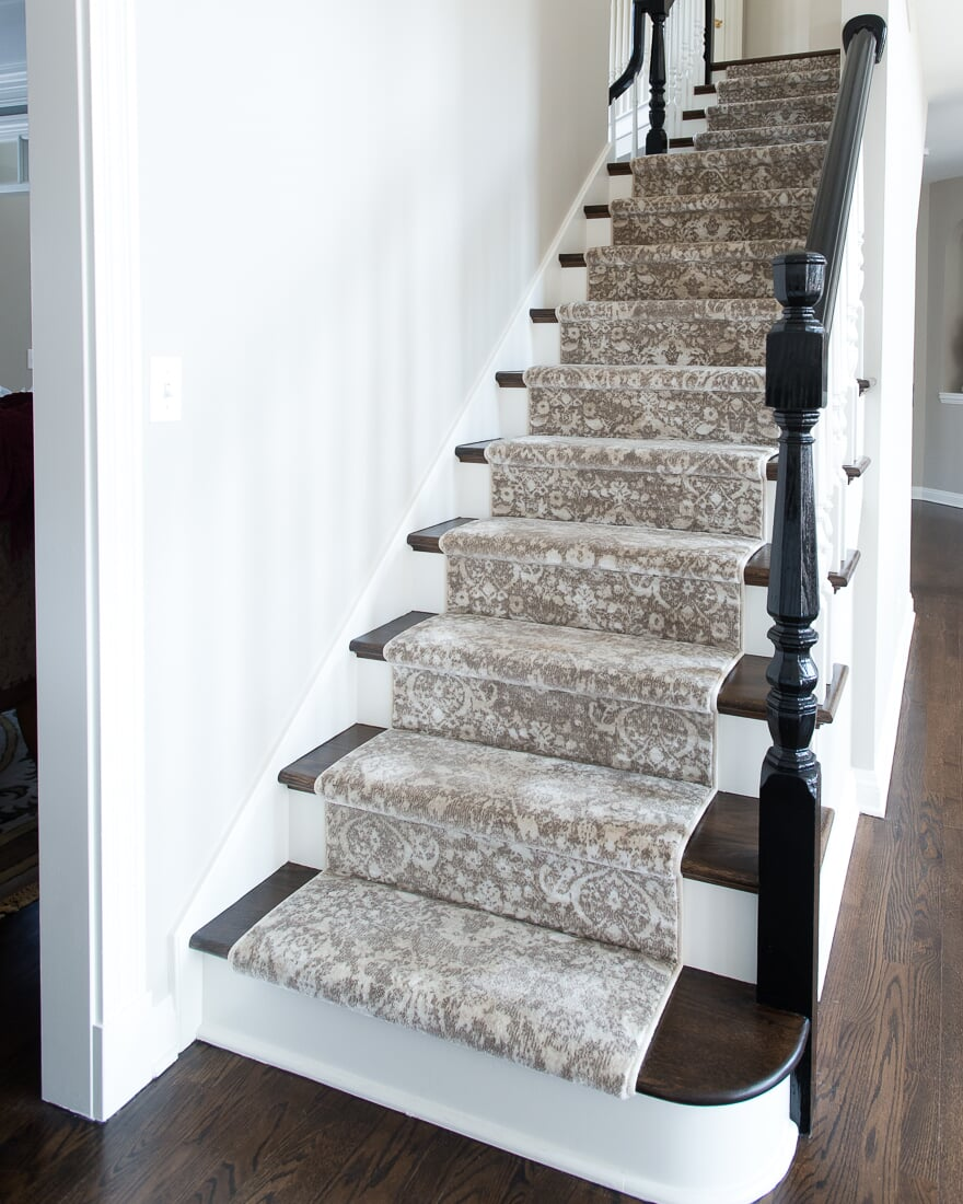 Light carpet runner on dark wood stairs in Elburn, IL from Carlson's Floors