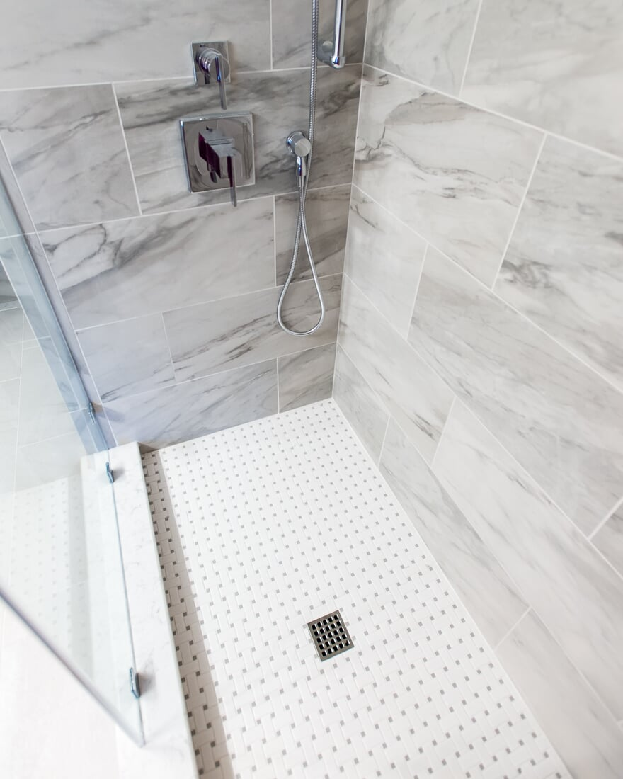 Marble tile shower in Geneva, IL from Carlson's Floors