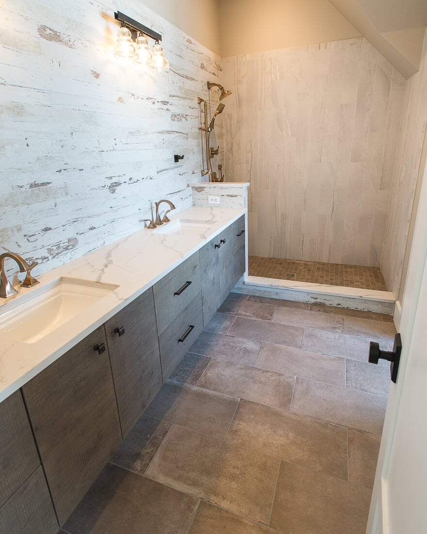 Rustic master bathroom design in Lake Holiday, IL from Carlson's Floors