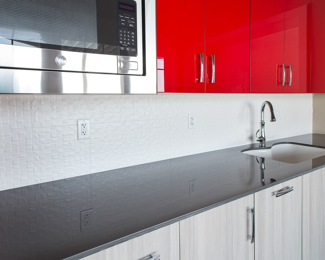 Bright red statement cabinetry in Lake Holiday, IL from Carlson's Floors