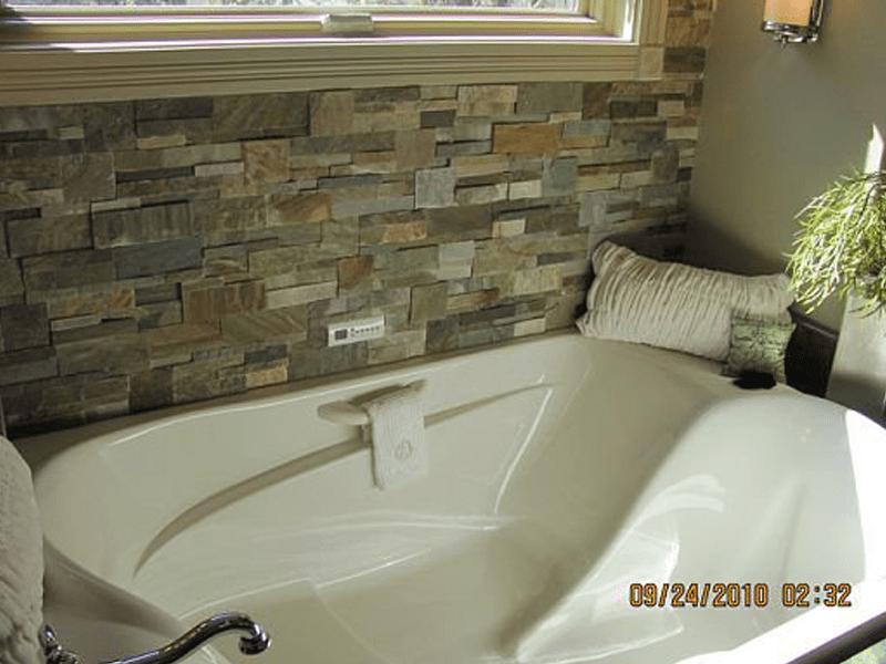 Stone tile backsplash in Joplin, MO from Joplin Floor Designs