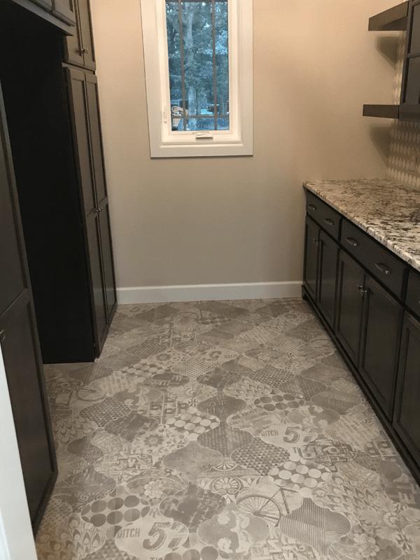 Patterned tile flooring in [[cms:city10] from Joplin Floor Designs
