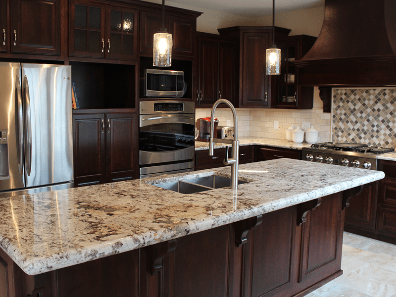 Beige-tone granite countertops in Carthage, MO from Joplin Floor Designs