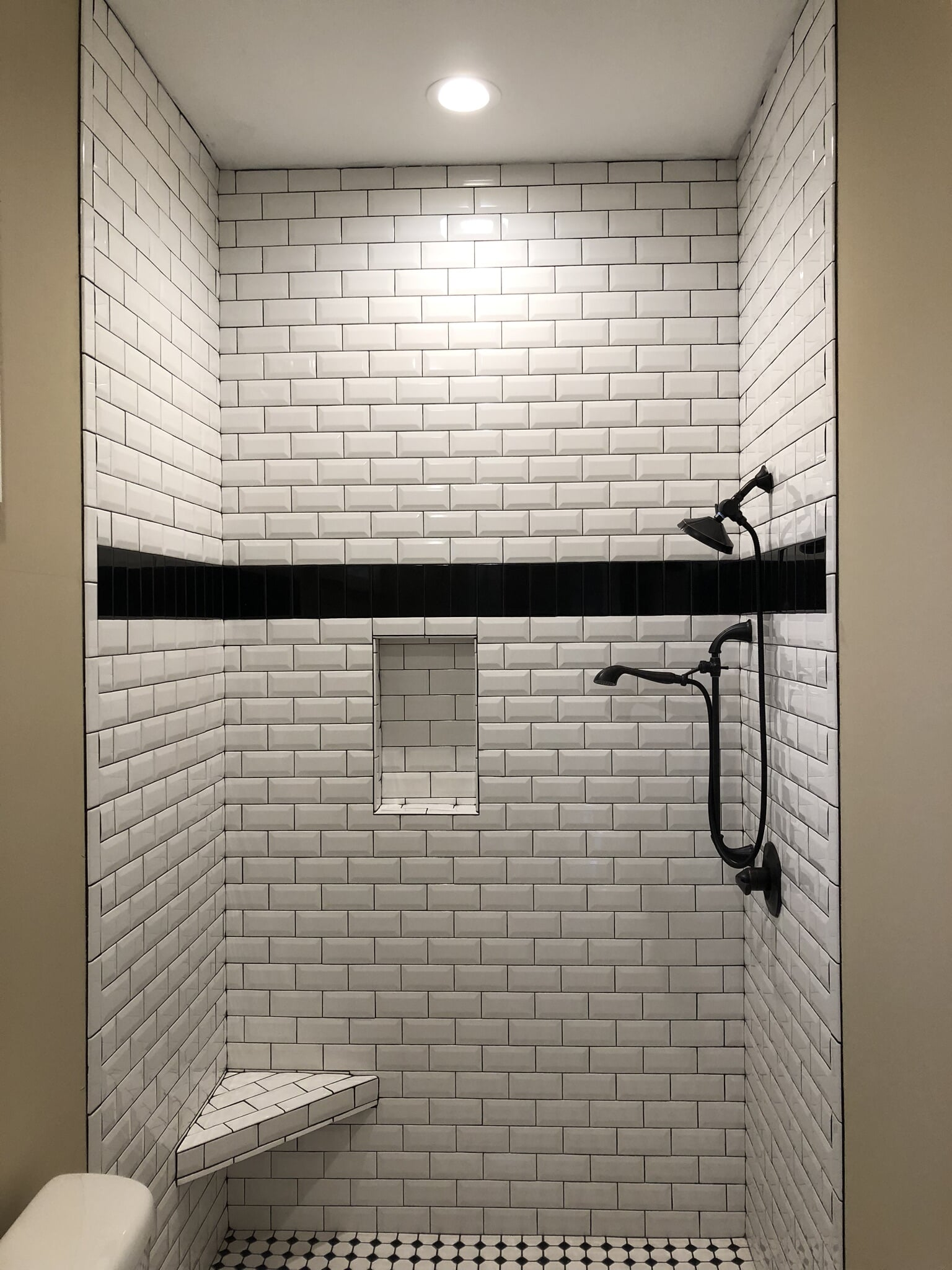 Subway tile shower installation in Fairhope, AL from G & J Tile & Floor Covering