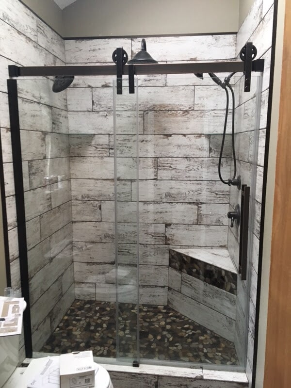 Modern black shower hardware in Foley, AL from G & J Tile & Floor Covering
