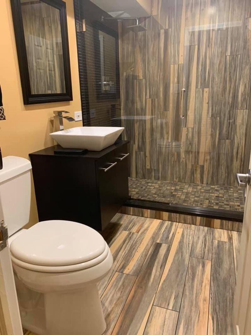 Rustic tile bathroom in Mundelein, IL from Wholesale Carpet Designs