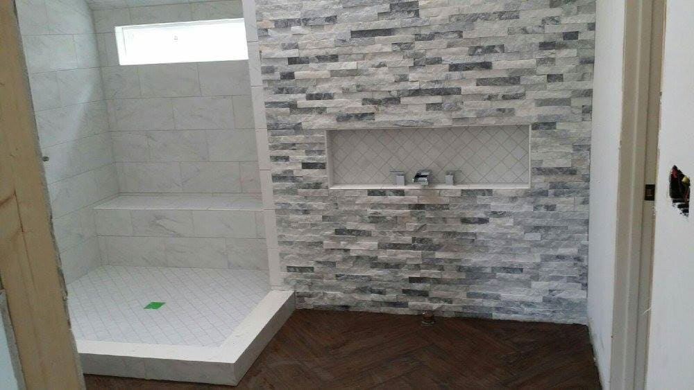 Natural stone shower installation in Charlotte, NC from Custom Floor Solutions