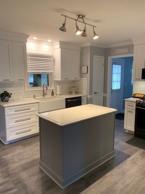 White cabinetry with a gray island in Harrisburg, NC from Custom Floor Solutions