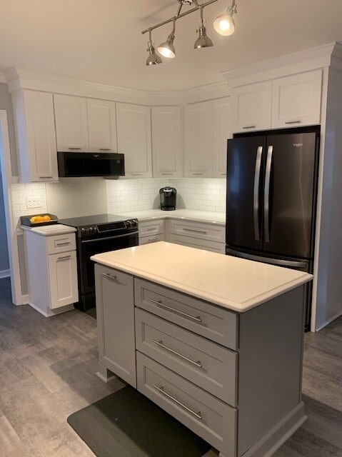 Gray kitchen island in Harrisburg, NC from Custom Floor Solutions