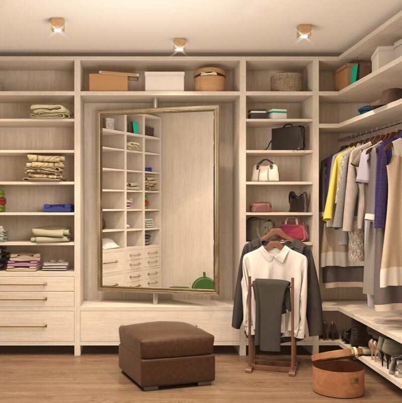 Walk in closet in Northville, MI from Esquire Interiors
