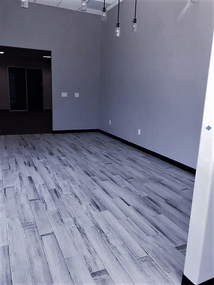 Grey wood look flooring in Irving, TX from SJ FloorSolutions LLC