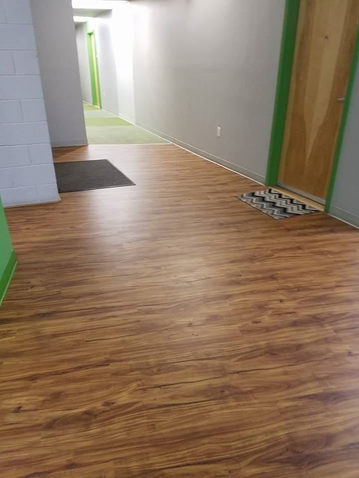 Wood look commercial flooring in Woodstock, VA from Strickler Carpet