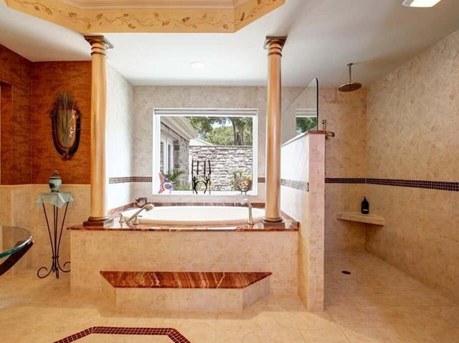 Grand tub surround and walk-in shower in Dunedin, FL from Floor Depot