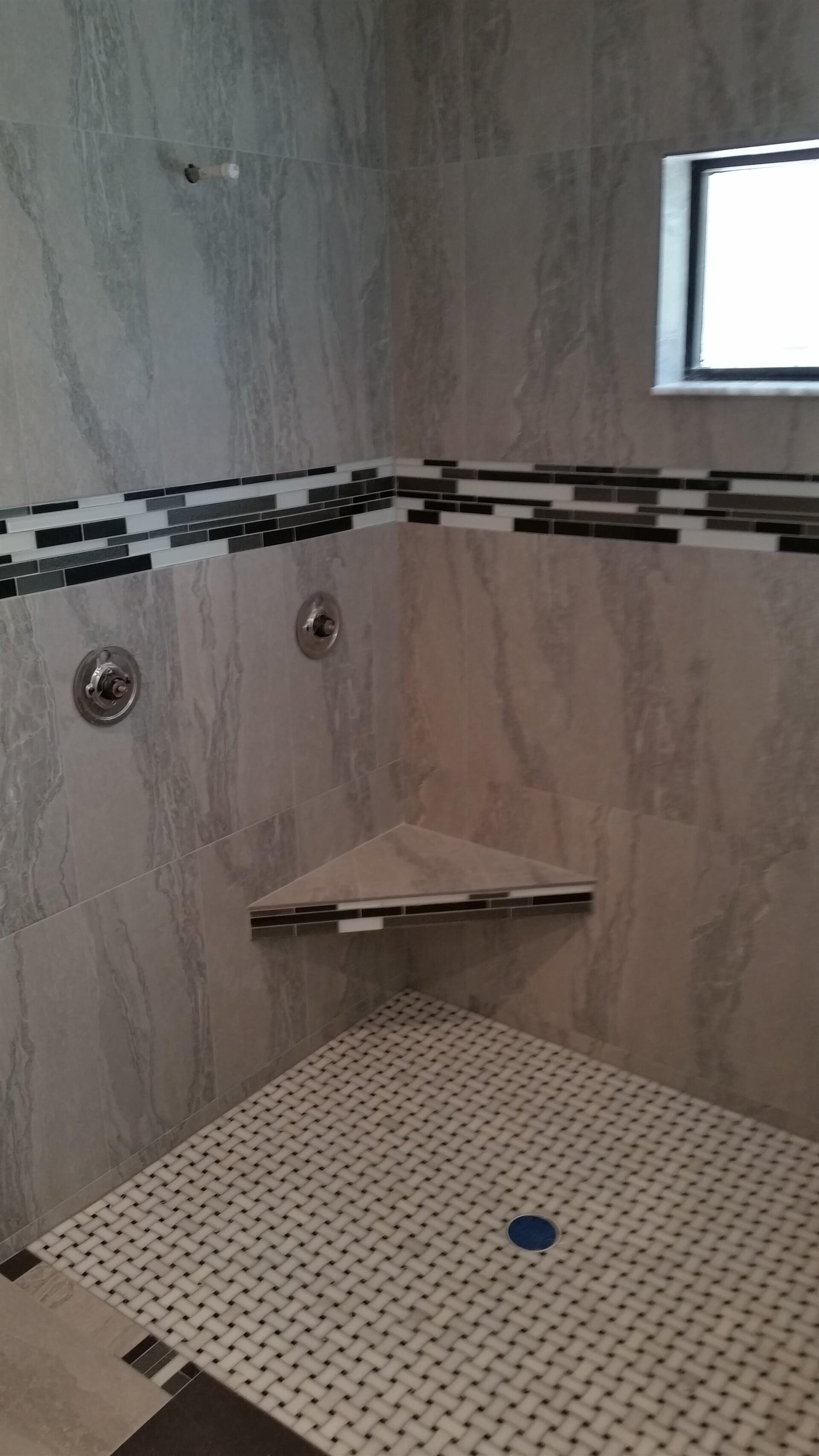 Black and white shower design in Dunedin, FL from Floor Depot