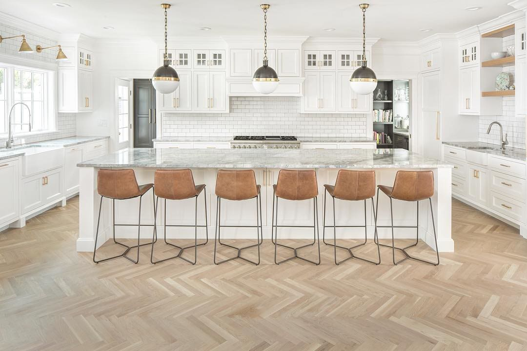 Huge open Stamford, CT kitchen with light herringbone hardwood flooring