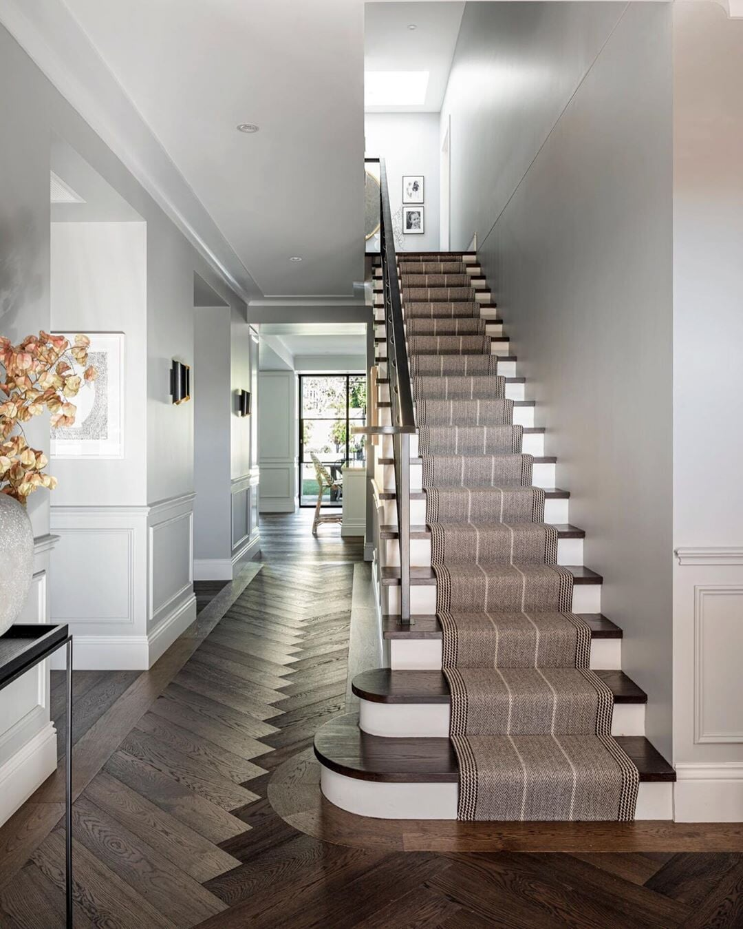 Dark herringbone hardwood flooring and stair tread in a Bridgeport, CT home