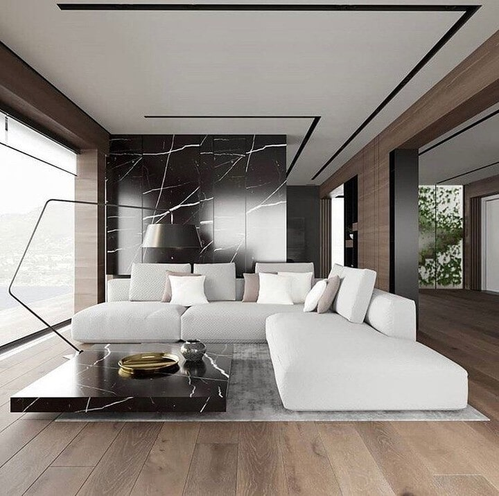 Modern Bridgeport, CT living space with black stone accents and medium tone wood flooring