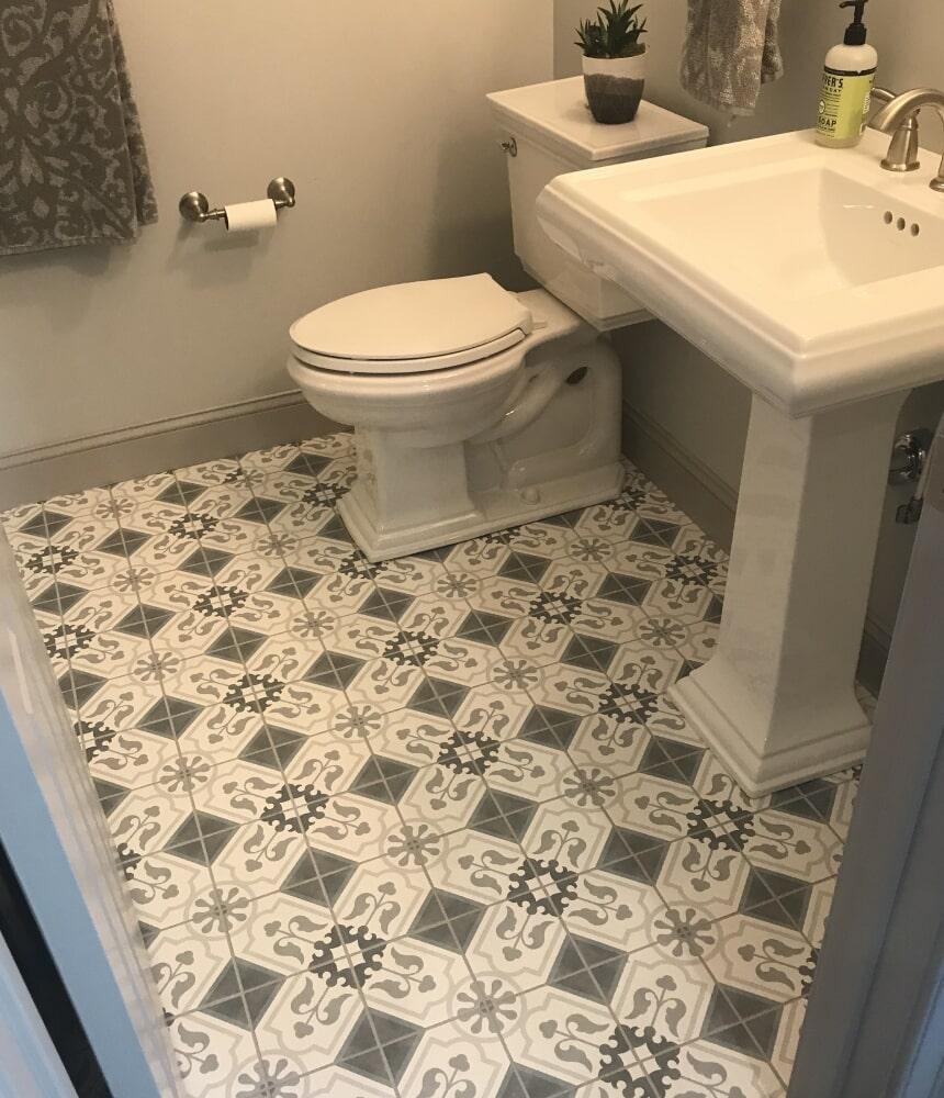 Ornate bathroom tile flooring in Cromwell, CT from Custom Floors