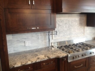Kitchen countertops and backsplash in Calgary, AB from Omega Flooring
