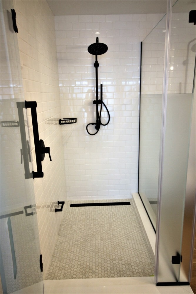 Brenton Hotel Shower Dal Tile Rittenhouse Squares Artic White Walls Upton Glass 1 inch Hex Mosaic Carrara Marble in Sandwich, MA from Paramount Rug Company