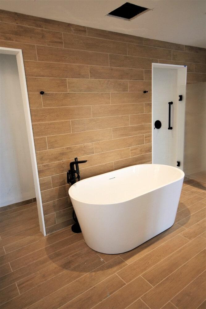 Newport RI Brenton Hotel Suite Bathroom Ceramic Technics Canterino Ecowood 6 inches by 36 inches in Cape Cod, MA from Paramount Rug Company