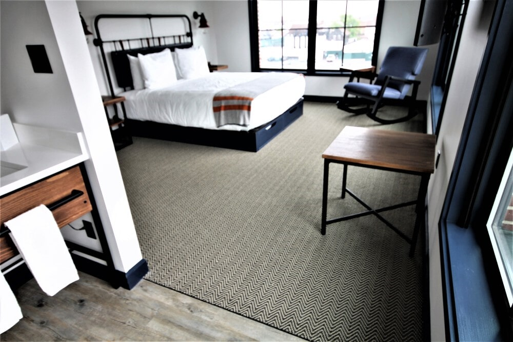 Newport RI Hammetts Wharf Hotel Suite Parterre Flooring Vertu 6x36 plank Lancaster Patina  Shaw Herringbone Carpet in Hyannis, MA from Paramount Rug Company