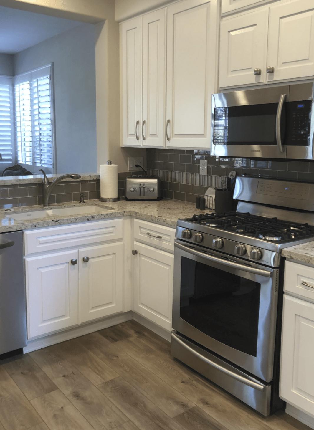 Modern white cabinetry in Orange, CA from TS Home Design Center / Rite Loom Flooring