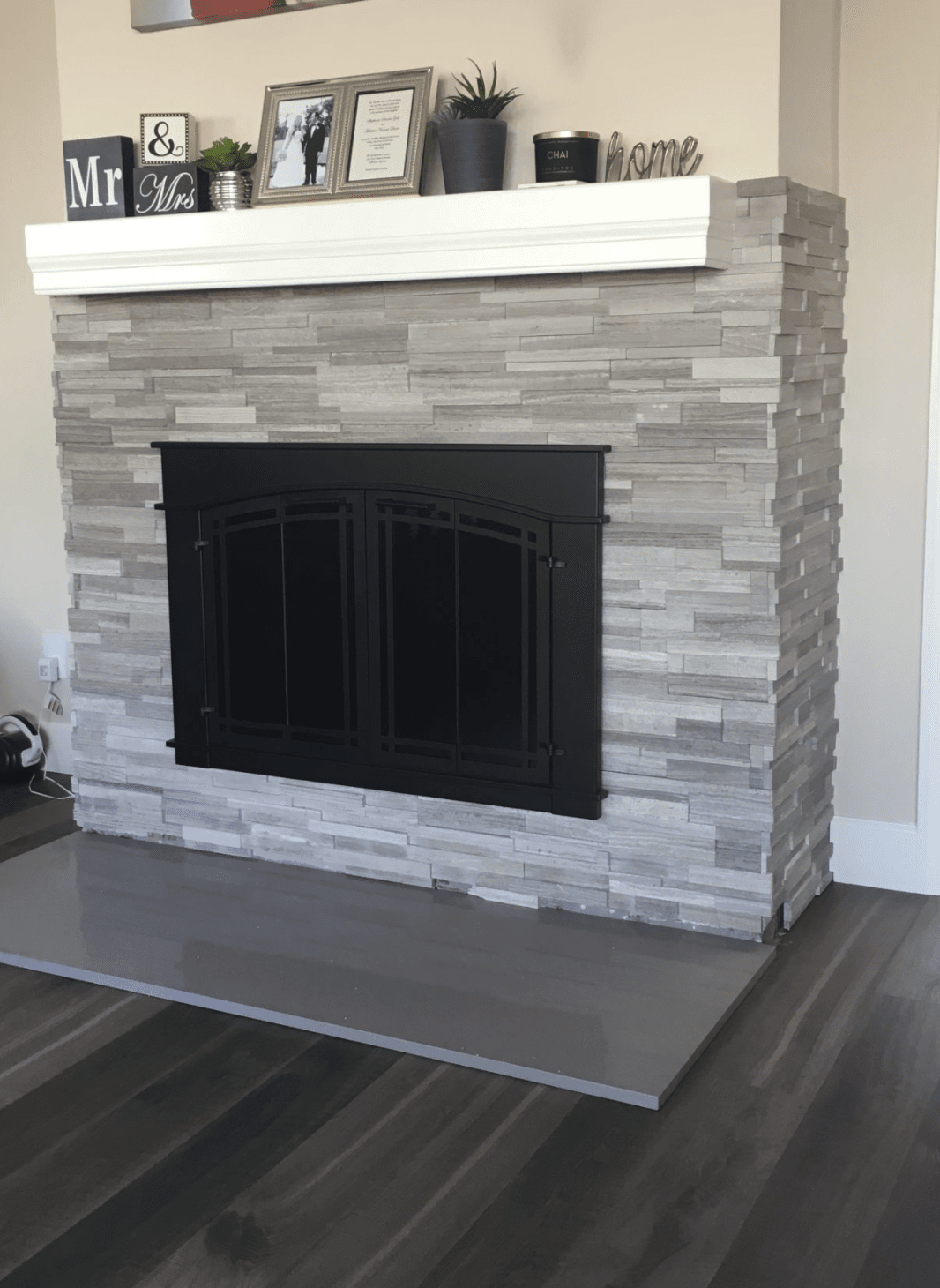 Stone fireplace surround in Yorba Linda, CA from TS Home Design Center / Rite Loom Flooring