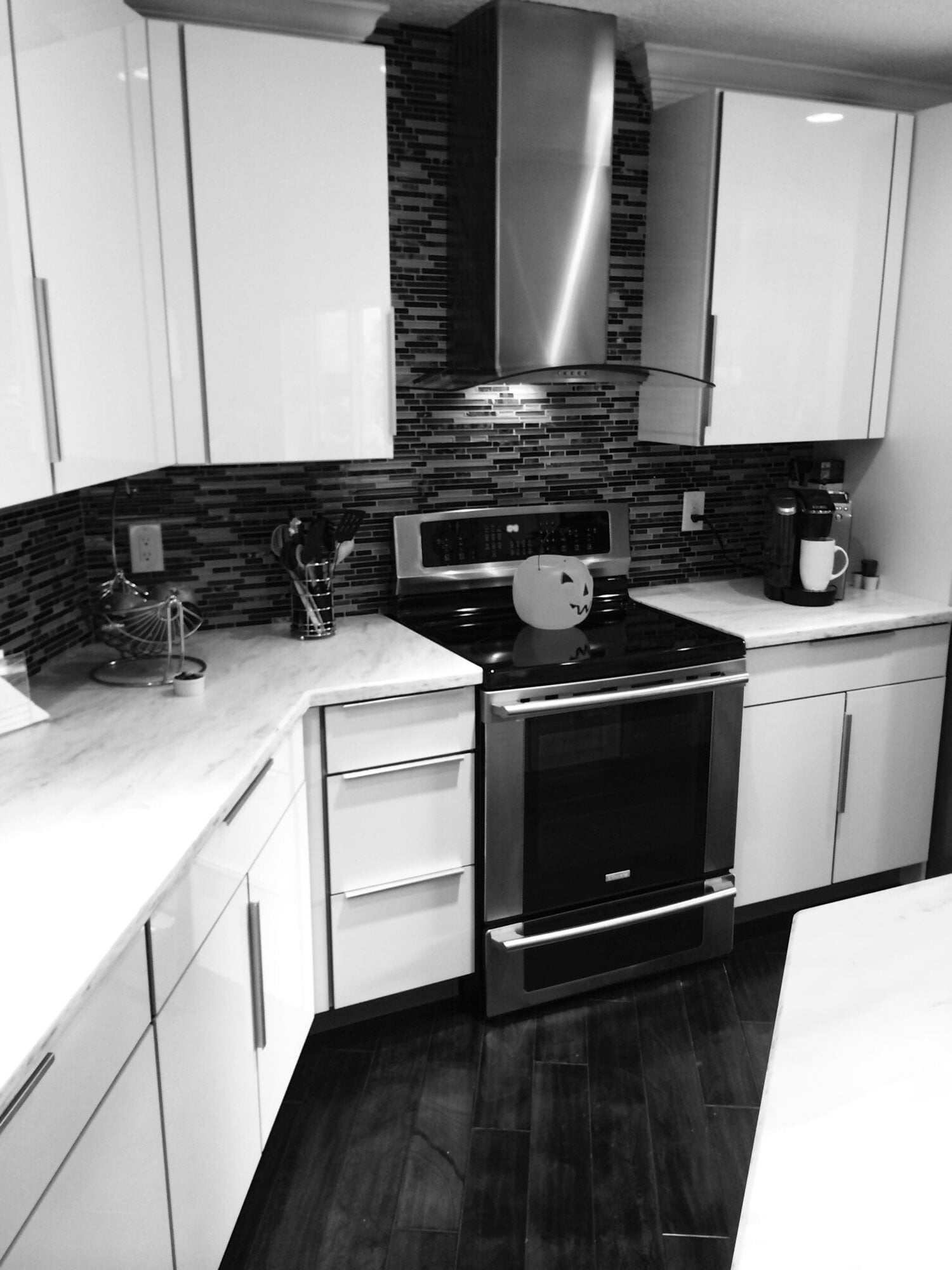 Gorgeous monochrome kitchen design in Palm Beach Gardens, FL from Floors For You Kitchen & Bath