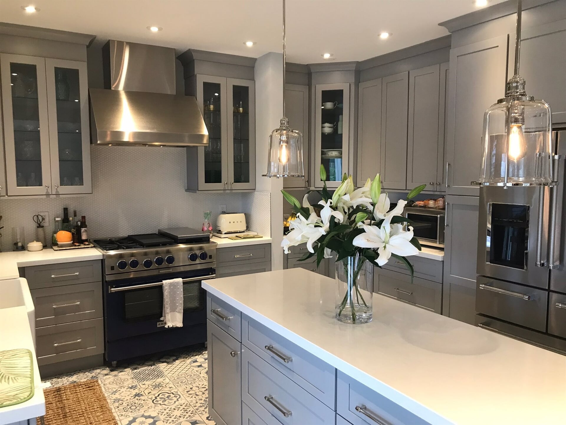 Grey kitchen design in Juno Beach, FL from Floors For You Kitchen & Bath
