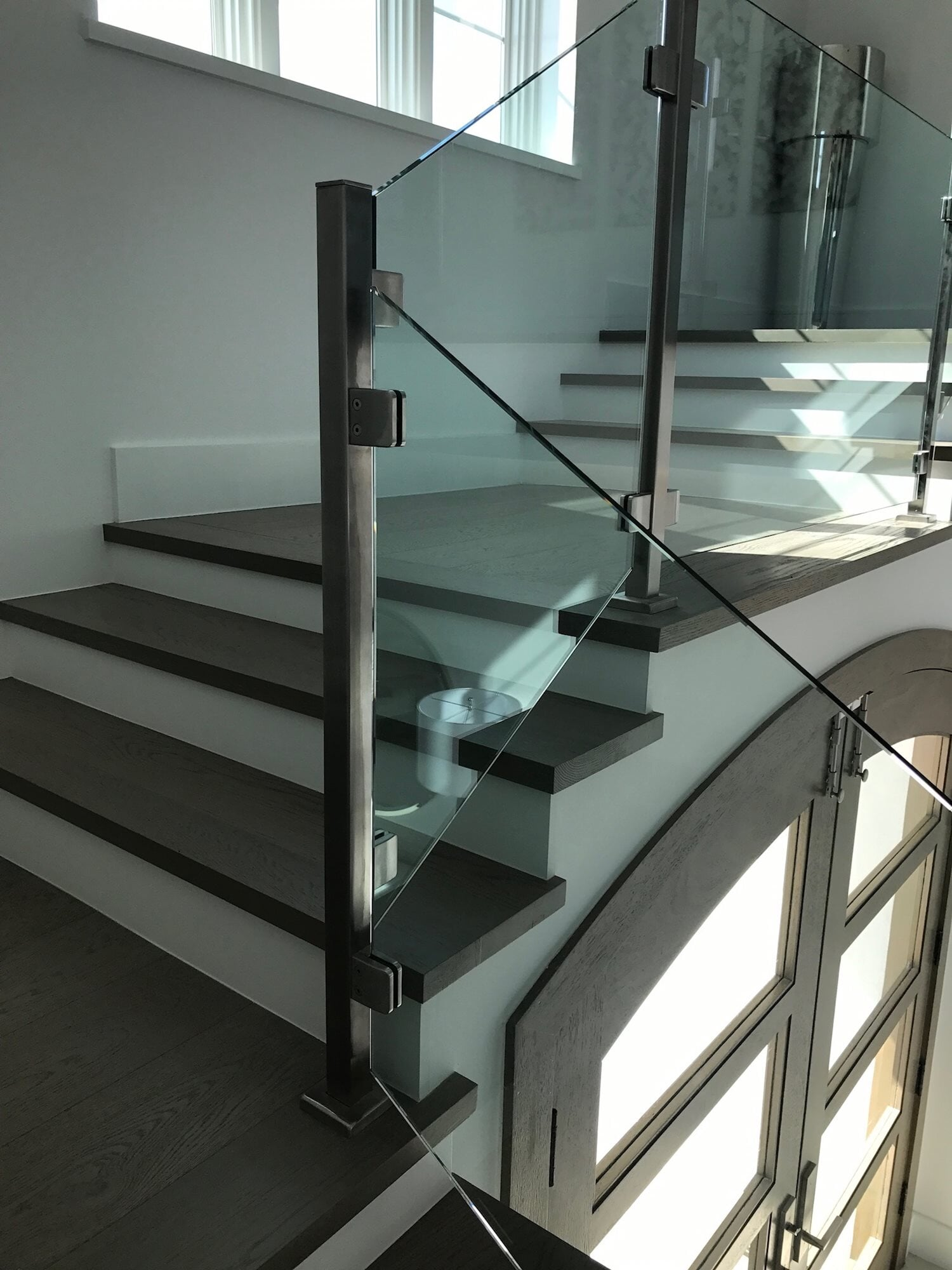 Modern glass stair rail in Boca Roton, FL from Floors For You Kitchen & Bath