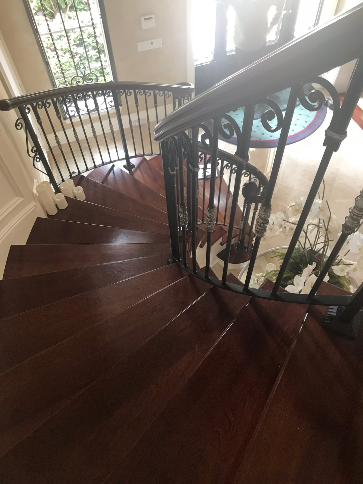Spiral wood stairs in Juno Beach, FL from Floors For You Kitchen & Bath