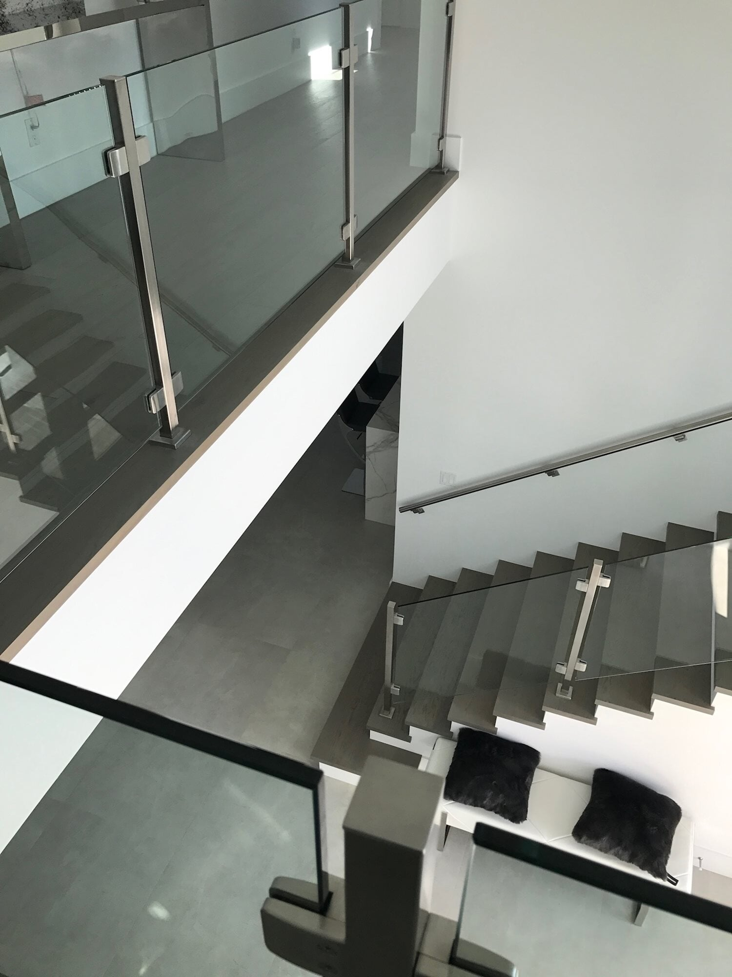 Modern stairway design in Palm Beach Gardens, FL from Floors For You Kitchen & Bath
