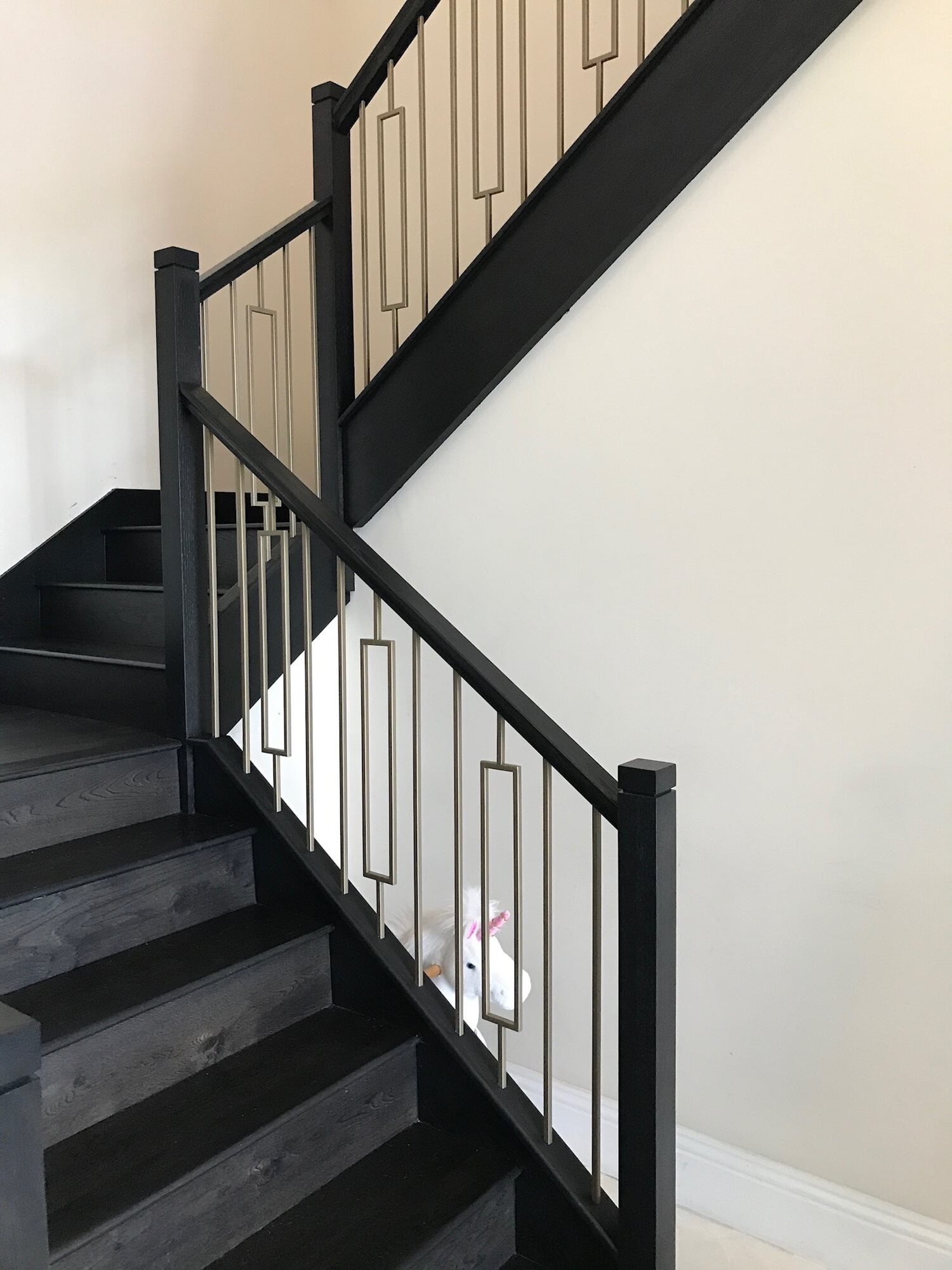 Dark grey wood stairs in Boca Roton, FL from Floors For You Kitchen & Bath
