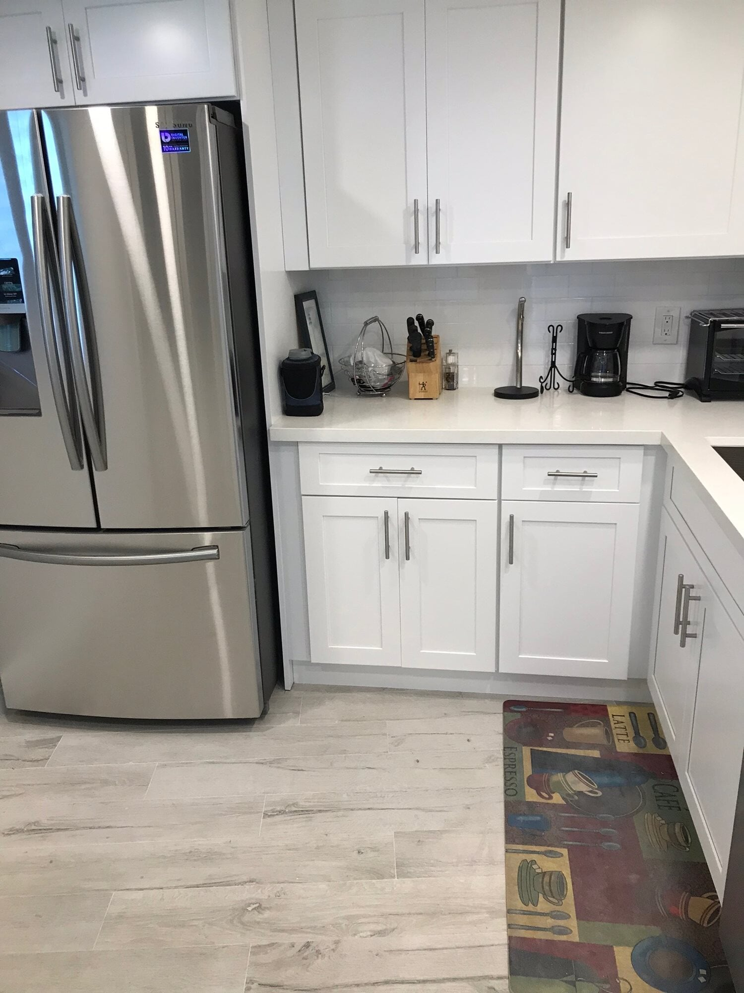 White wood look kitchen floors in Palm Beach Gardens, FL from Floors For You Kitchen & Bath