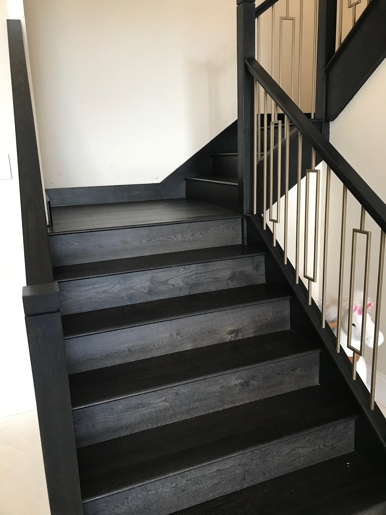 Custom black stairway in Boca Roton, FL from Floors For You Kitchen & Bath