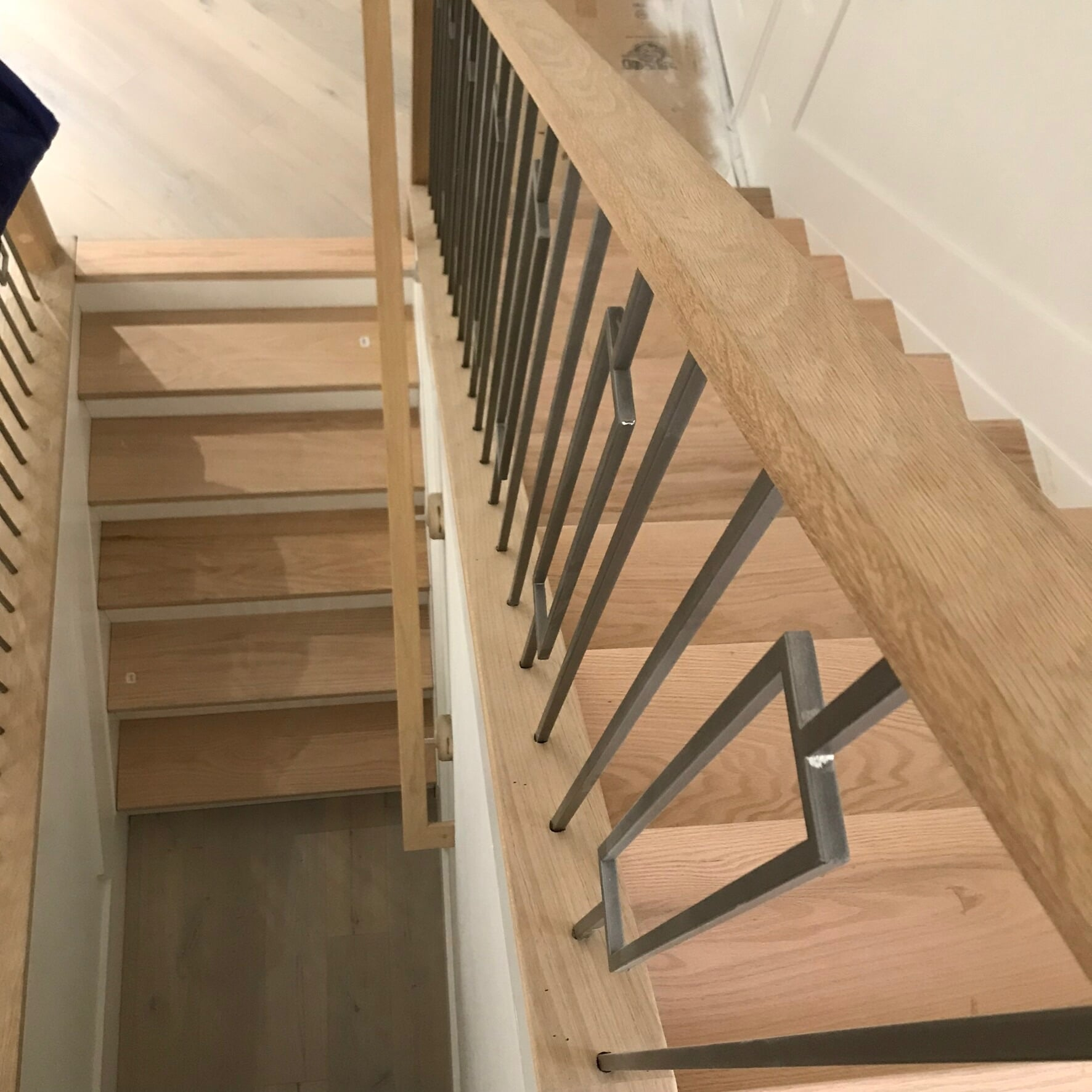 Light tone wood stairs in Jupiter, FL from Floors For You Kitchen & Bath