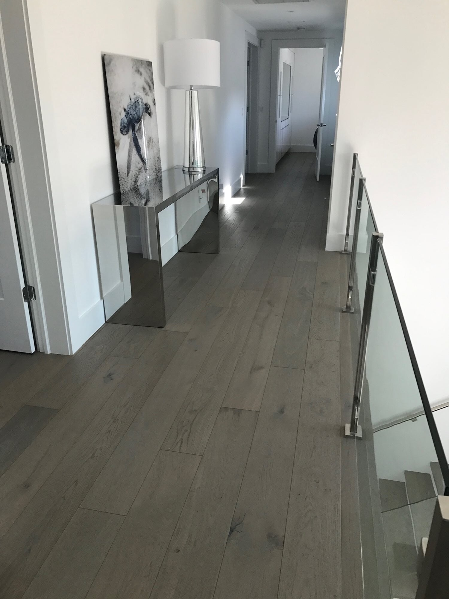 Grey tone wood floors in Palm Beach Gardens, FL from Floors For You Kitchen & Bath