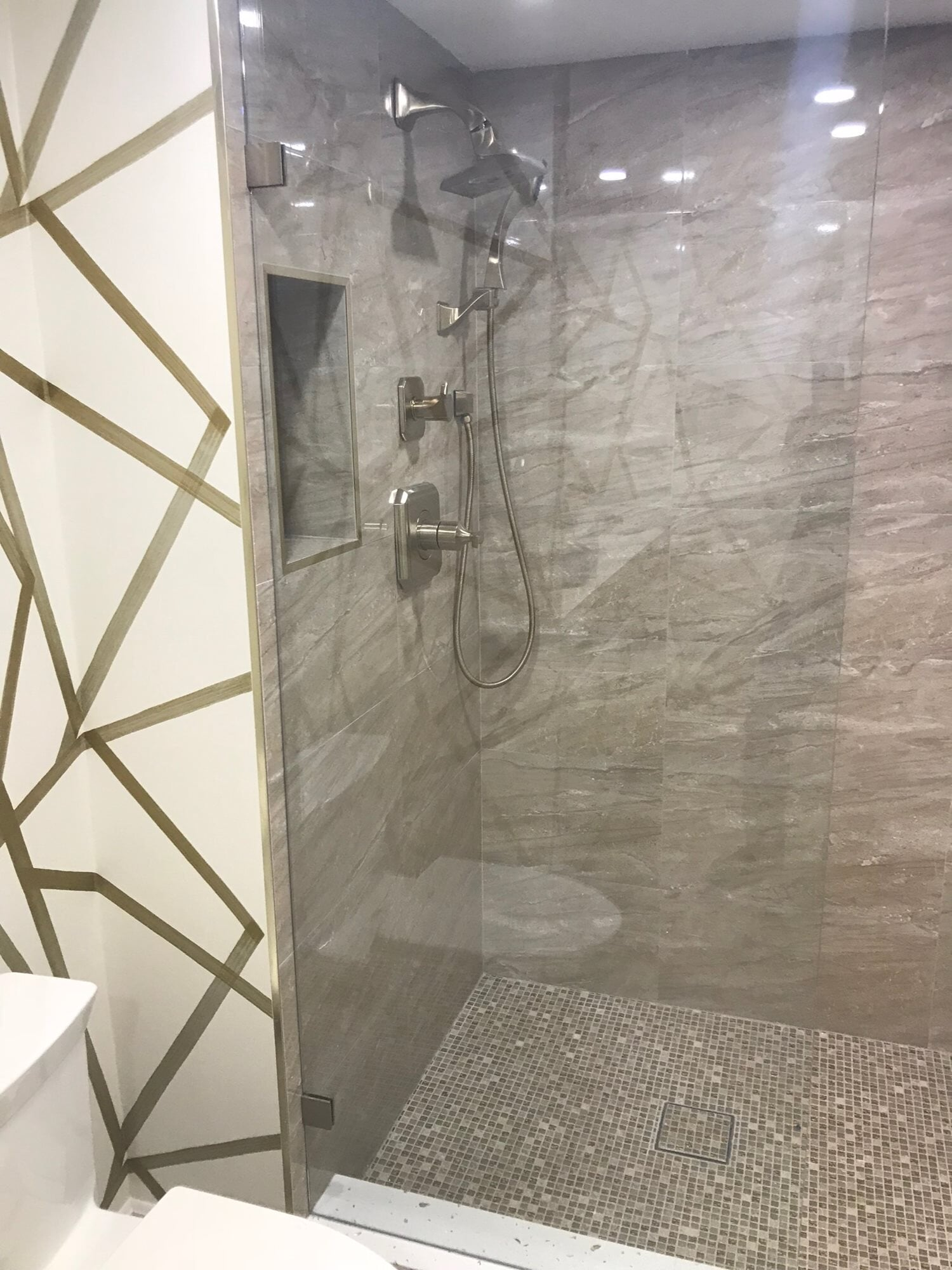 Stone tile shower in Hobe Sound, FL from Floors For You Kitchen & Bath