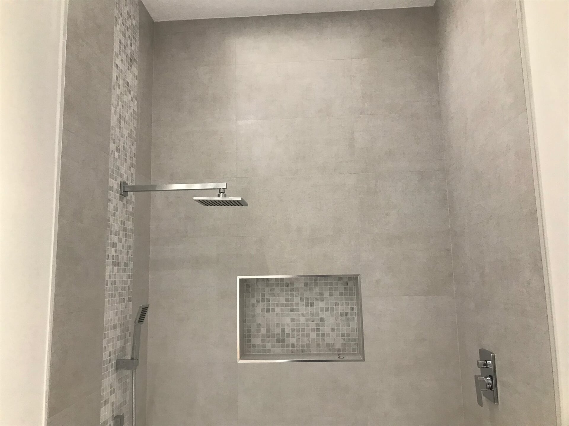 Tall open shower in West Palm Beach, FL from Floors For You Kitchen & Bath