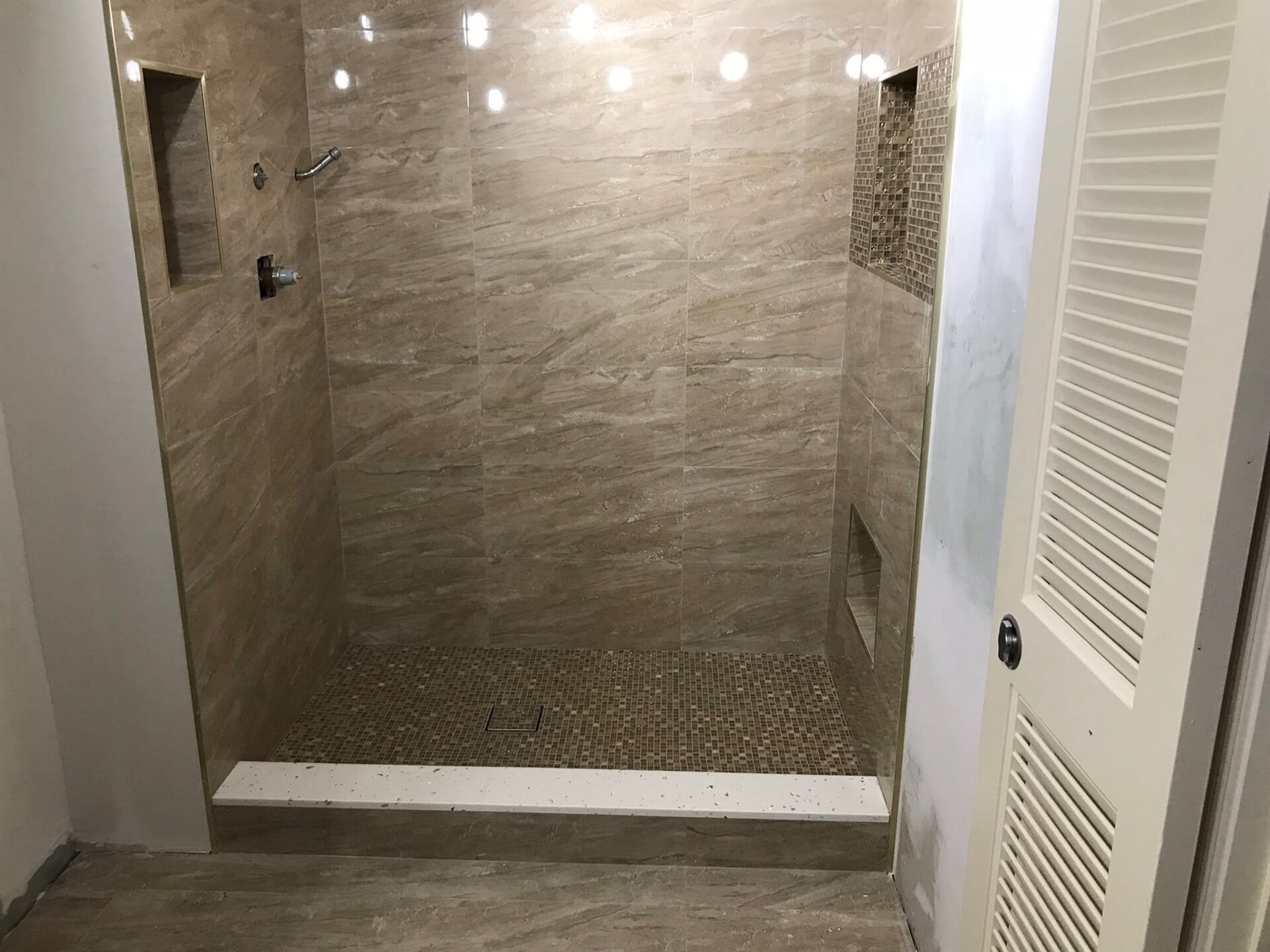 Textured stone shower in Palm Beach Gardens, FL from Floors For You Kitchen & Bath