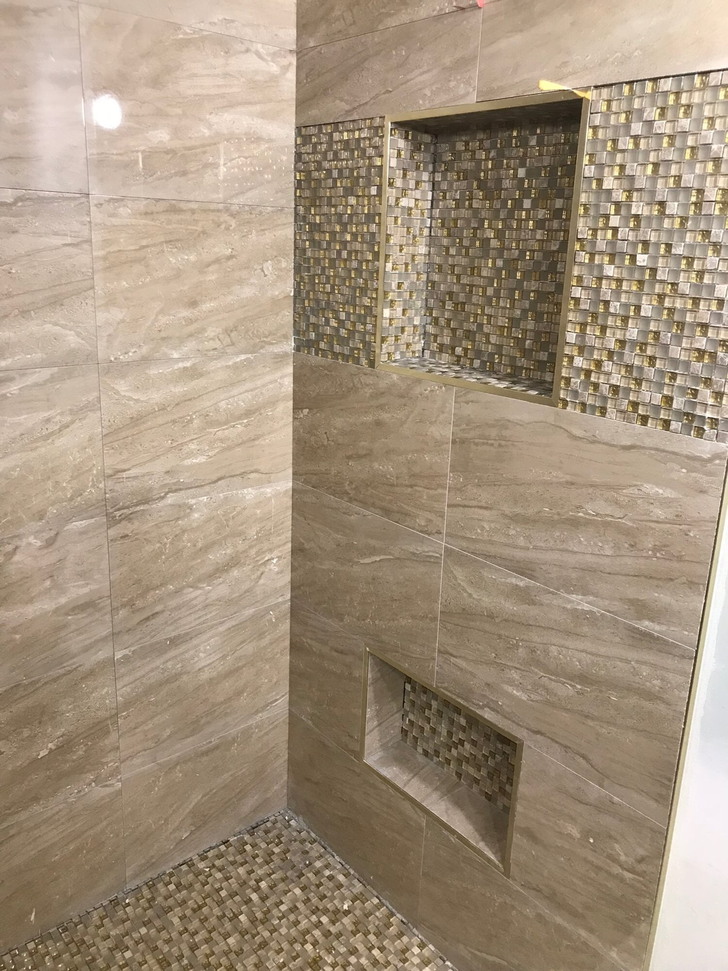 Custom recessed shower shelves in Palm Beach Gardens, FL from Floors For You Kitchen & Bath